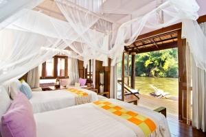 Une chambre d'un bungalow du Float House River Kwai